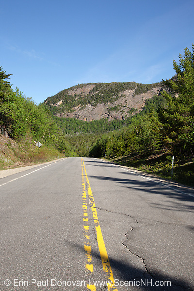 The Kancamagus Highway (route 112) which is one of New England's scenic byways in the White Mountains, New Hampshire USA. Mount Huntington is in the background