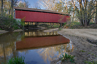 The Melcher Covered Bridge is 83 feet long and crosses Leatherwood Creek in Parke County, Indiana and is shpwn here in Spring