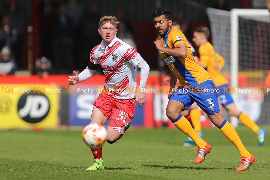 Mark McKee of Stevenage evades Malvind Benning of Mansfield Town during Stevenage vs Mansfield Town, Sky Bet EFL League 2 Football at the Lamex Stadium on 22nd April 2017