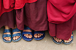 Feet of three child monks, Paro Valley, Bhutan