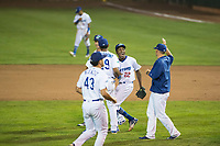 Ogden Raptors relief pitcher Luis Pasen (22) celebrates a victory with teammates including Jefrey Souffront (29), Dillon Paulson (14) and Reza Aleaziz (43) after a Pioneer League game against the Great Falls Voyagers at Lindquist Field on August 23, 2018 in Ogden, Utah. The Ogden Raptors defeated the Great Falls Voyagers by a score of 8-7. (Zachary Lucy/Four Seam Images)
