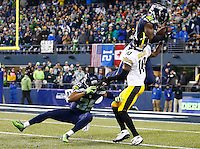 Kam Chancellor #31 of the Seattle Seahawks intercepts a pass in front of Martavis Bryant #10 of the Pittsburgh Steelers in the fourth quarter during the game at CenturyLink Field on November 29, 2015 in Seattle, Washington. (Photo by Jared Wickerham/DKPittsburghSports)