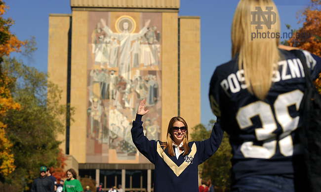 Junior Stacey Milspaw takes a photo of her best friend Kelsey Adams, visiting from Atlanta...Photo by Matt Cashore/University of Notre Dame