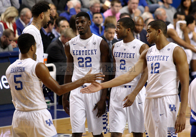 The UK team walks on the court during the first half of the University of Kentucky men's basketball game vs. Eastern Kentucky University at Rupp Arena in Lexington, Ky., on Sunday, December 7, 2014. UK won 82 - 49. Photo by Tessa Lighty | Staff