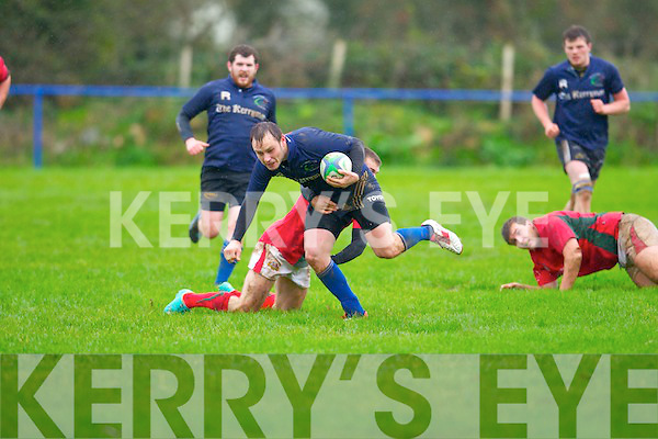 Tralee's Eoin Murphy gets away from the tackle of Clonakilty's Kieran Howlin in the Munster Junior league at O'Dowd park, Tralee on Sunday.