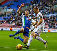 Leeds United's Liam Cooper is closed down by Wigan Athletic's Dan Burn<br /> <br /> Photographer Alex Dodd/CameraSport<br /> <br /> The EFL Sky Bet Championship - Wigan Athletic v Leeds United - Sunday 4th November 2018 - DW Stadium - Wigan<br /> <br /> World Copyright &copy; 2018 CameraSport. All rights reserved. 43 Linden Ave. Countesthorpe. Leicester. England. LE8 5PG - Tel: +44 (0) 116 277 4147 - admin@camerasport.com - www.camerasport.com