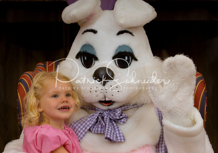 A young girl sits with the Easter Bunny during a holiday party at Berewick master-planned community in southwest Mecklenburg County, Charlotte, NC. The property is developed by Pappas Properties.