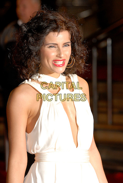 "NELLY FURTADO.Arriving at the 2007 ""Brit Awards"" at Earls Court, London, England, 14th February 2007..half length white dress.CAP/FIN.©Steve Finn/Capital Pictures."