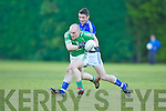 Jerome Flynn  Milltown Castlemaine gets to the ball ahead of Maurice Foley Laune Rangers during the Mid Kerry final in Beaufort on Saturday