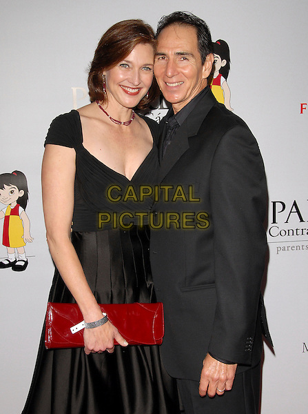 BRENDA STRONG & GUEST.The 7th Annual El Sueno de Esperanza Benefit Gala to raise funds for Padres Contra El Cancer held at The Lot in West Hollywood, California, USA..October 18th, 2007.half length black red dress clutch purse suit jacket.CAP/DVS.©Debbie VanStory/Capital Pictures
