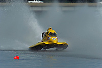 Terry Rinker (#10) races through the spray of the first lap of the final heat.