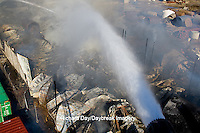 63818-02403 Firefighters extinguishing warehouse fire using aerial ladder truck viewed from top of ladder, Salem, IL