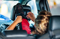 Jul 19, 2020; Clermont, Indiana, USA; NHRA top fuel driver Leah Pruett ties her racing shoe during the Summernationals at Lucas Oil Raceway. Mandatory Credit: Mark J. Rebilas-USA TODAY Sports