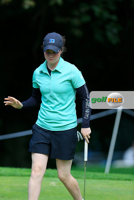 Leona Maguire (AM)(IRL) sinks her birdie putt on the 6th green during Sunday's Final Round of the LPGA 2015 Evian Championship, held at the Evian Resort Golf Club, Evian les Bains, France. 13th September 2015.<br /> Picture Eoin Clarke | Golffile