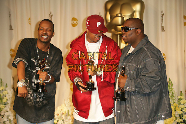 THREE 6 MAFIA.The 78th Annual Academy Awards - Press Room, held at the Kodak Theatre, Los Angeles, California, USA, .5th March 2006..oscars half length 3 six holding oscars funny .Ref: ADM/RE.www.capitalpictures.com.sales@capitalpictures.com.©Russ Elliot/AdMedia/Capital Pictures.