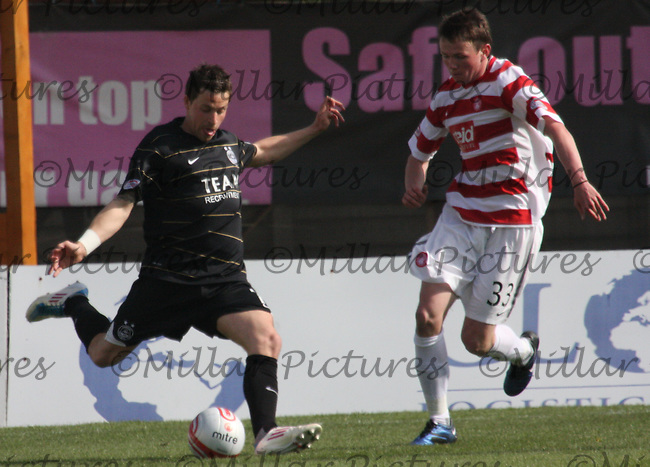 Chris Maguire crossing under pressure from Lee Kilday