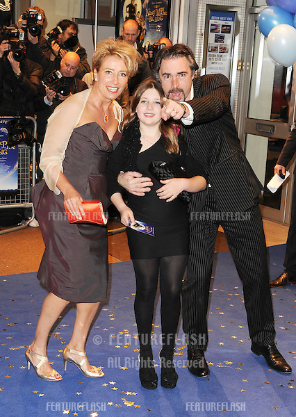 Emma Thompson, Greg Wise and daughter arriving for the 'Nanny McPhee and the Big Bang' premiere at the Odeon West End, Leicester Square, London.  24/03/2010  Picture by: Simon Burchell / Featureflash