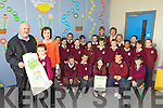 Third class pupils at Scoil Iosagain, Ballybunion were delighted that classmate Andrew O'Connor, pictured with his mom Claire Leane and postmaster Michael Joyce, won the 2013 An Post Impostipuzzle competition gaining ?100 for himself and ?500 for his class.
