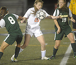 (worcester Ma 111513) Newton North 25, Christina Callahan takes the ball off her chest,  surrounded by Minnechaug 8, Jaileen Goncalves and 18, Marissa Falcetti, during the MIAA State Girls Soccer Division 1 final, Friday, at Worcester State College in Worcester. (Jim Michaud Photo) For Saturday
