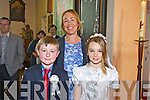 Children from Flemby National School Jack O'Flaherty and Snjezana Herbst with their Teacher Fiona Cooke at their First Holy Communion in the church of the Immaculate Conception Ballymac,