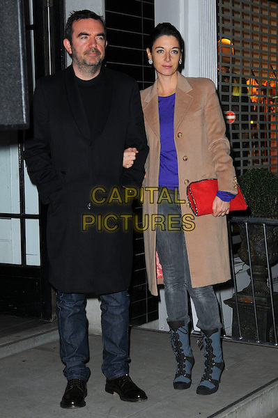SIMON ABOUD & MARY McCARTNEY .Stella McCartney Store Christmas Lights Switch-on, Bruton Street, London, England, UK, November 22nd 2010..full length couple  black camel coat walking grey gray denim jeans boots red clutch bag purple top blue .CAP/CAS.©Bob Cass/Capital Pictures.