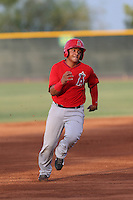Jeyson Sanchez (16) of the AZL Angels runs the bases during a game against the AZL Rangers at the Texas Rangers Spring Training Complex on July 1, 2015 in Surprise, Arizona. Rangers defeated the Angels, 3-1. (Larry Goren/Four Seam Images)