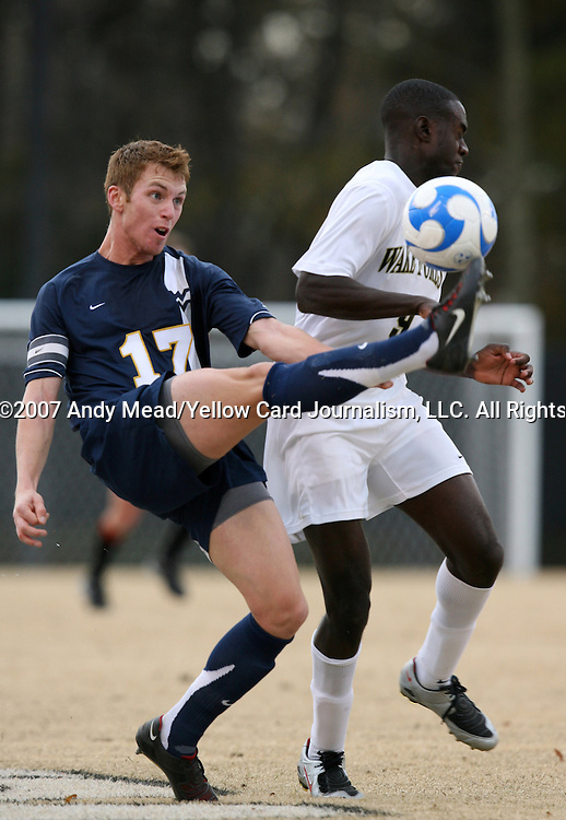 02 December 2007: West Virginia's Andrew Halsell (17) clears the ball away from Wake Forest's Marcus Tracy (9). The Wake Forest University Demon Deacons defeated the West Virginia University Mountaineers 3-1 at W. Dennie Spry Soccer Stadium in Winston-Salem, North Carolina in a Third Round NCAA Division I Mens Soccer Tournament game.