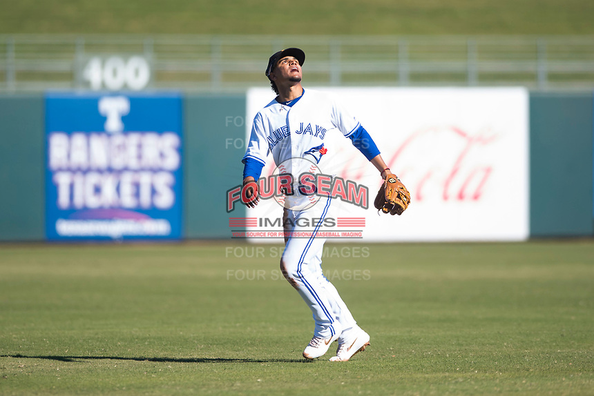 Surprise Saguaros shortstop Santiago Espinal (6), of the Toronto Blue Jays organization, makes the call to catch a pop fly during an Arizona Fall League game against the Glendale Desert Dogs at Surprise Stadium on November 13, 2018 in Surprise, Arizona. Surprise defeated Glendale 9-2. (Zachary Lucy/Four Seam Images)