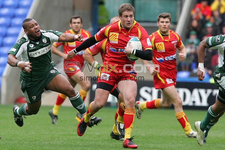 PIX: Rugby. Heieken Cup, Quarter-Final, London Irish-Perpignan, Madejski Stadium, Reading, 5th April 2008...COPYRIGHT PICTURE>> SIMON WILKINSON>>0870 092 0092>>....Jean-Philippe GRANDCLAUDE evades Steffon ARMITAGE...............