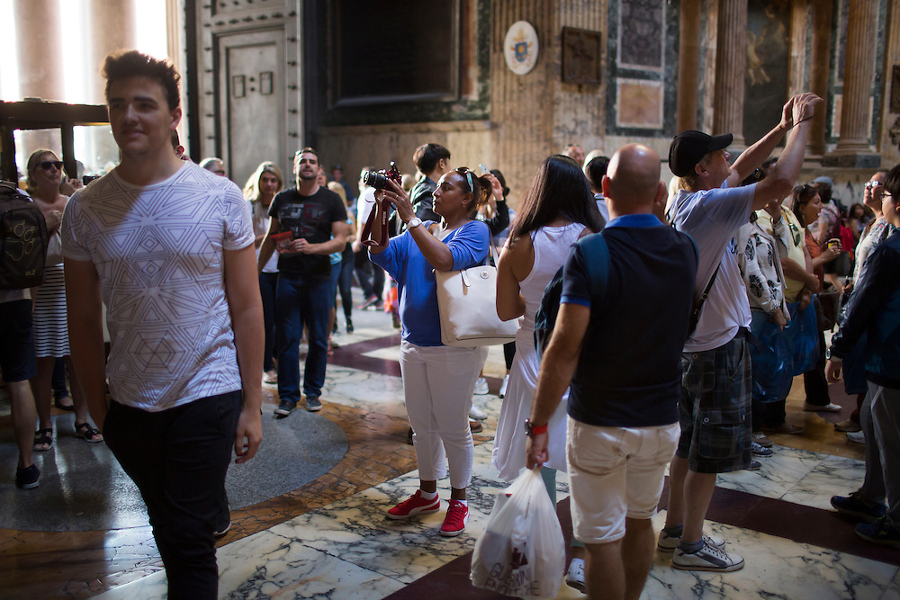 A tourist takes a picture inside the Pantheon on Thursday, Sept. 24, 2015, in Rome, Italy. (Photo by James Brosher)