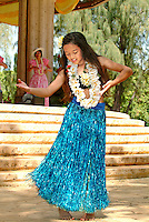 Hula girl wearing faux grass skirt and leis, performing on May 1, Lei Day at Kapiolani Park Bandstand.