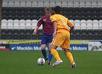 Jon Scullion takes on Jack Leitch in the St Mirren v Motherwell Clydesdale Bank Scottish Premier League U20 match played at St Mirren Park, Paisley on 10.9.12.