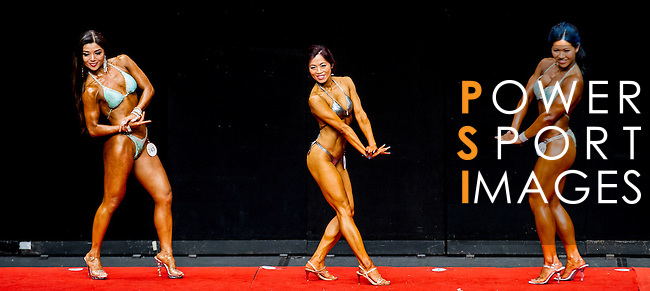 A bodybuilder competes in the Women's Athletic Physique category during the 2016 Hong Kong Bodybuilding Championships on 12 June 2016 at Queen Elizabeth Stadium, Hong Kong, China. Photo by Lucas Schifres / Power Sport Images