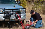 Off-road enthusiast fills tire on Toyota pickup on the trail with a Warn Powerplant compressor