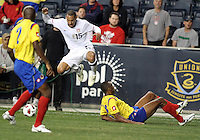 Jermaine Jones #15 of the USA MNT leaps to avoid a tackle from John Viafara #15 of Colombia during an international friendly match at PPL Park, on October 12 2010 in Chester, PA. The game ended in a 0-0 tie.