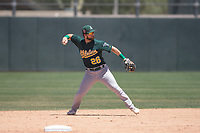 Oakland Athletics second baseman Ryan Gridley (26) prepares to make a throw to first base during an Extended Spring Training game against the San Francisco Giants Orange at the Lew Wolff Training Complex on May 29, 2018 in Mesa, Arizona. (Zachary Lucy/Four Seam Images)