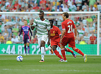 10th August 2013; Amido Balde, Glasgow Celtic, in action against, Lucas Leiva, Liverpool. Pre-season Friendly, Liverpool v Celtic, Dublin Decider, Aviva Stadium, Dublin. Picture credit: Tommy Grealy/actionshots.ie.