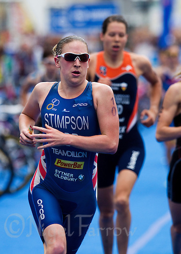 17 JUL 2011 - HAMBURG, GER - Jodie Stimpson (GBR) races out of transition during the women's Hamburg round of triathlon's ITU World Championship Series (PHOTO (C) NIGEL FARROW)