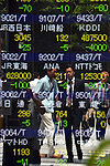 June 4, 2012, Tokyo, Japan - Pedestrians are reflected on the stocks board Monday, June 04, 2012, as the stocks open lower at the Tokyo Stock Exchange as investors unloaded shares amid growing fears of an economic slowdown in the U.S., Europe and China. (Photo by Natsuki Sakai/AFLO) AYF -mis-