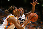 KNOXVILLE, TN--07 JANUARY 2005- 010706JS03-<br /> UConn's Charde Houston gets an arm in the face of Tennessee's Candace Parker while defending her during their game Saturday at the Thompson-Boling Arena in Knoxville, Tennessee. <br />  --Jim Shannon Republican American--UConn; Tennessee; Thompson-Boling Arena; Knoxville; Tennessee; Candace Parker; Charde Houston are CQ