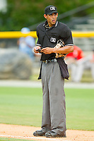 Home plate umpire Ronnie Whiting makes changes to his lineup card during the Appalachian League game between the Greeneville Astros and the Burlington Royals at Burlington Athletic Park on July 1, 2013 in Burlington, North Carolina.  The Astros defeated the Royals 7-0 in Game One of a doubleheader.  (Brian Westerholt/Four Seam Images)