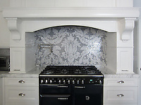 This custom kitchen features a handmade Kingston Lacy mosaic backsplash shown in Calacatta Tia and Bardiglio by Rogers &amp; Goffigon for New Ravenna.<br />