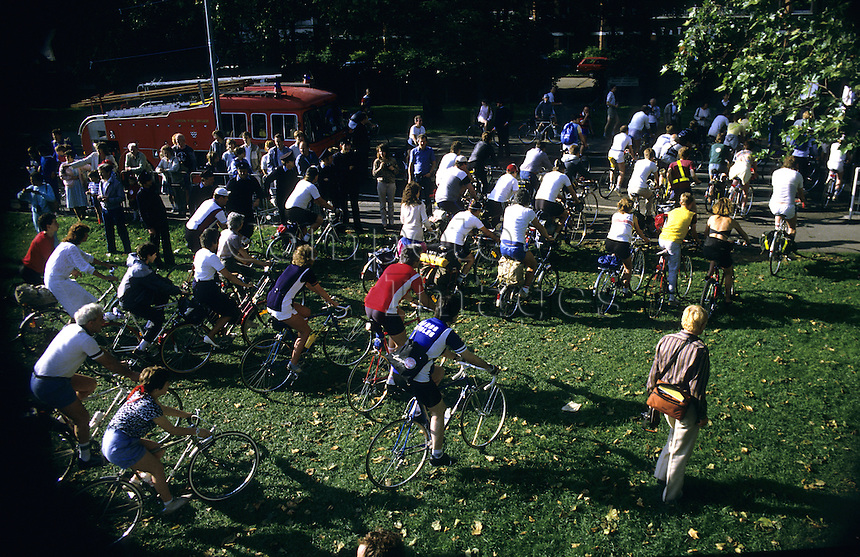 Large group of cyclists leaving a starting line