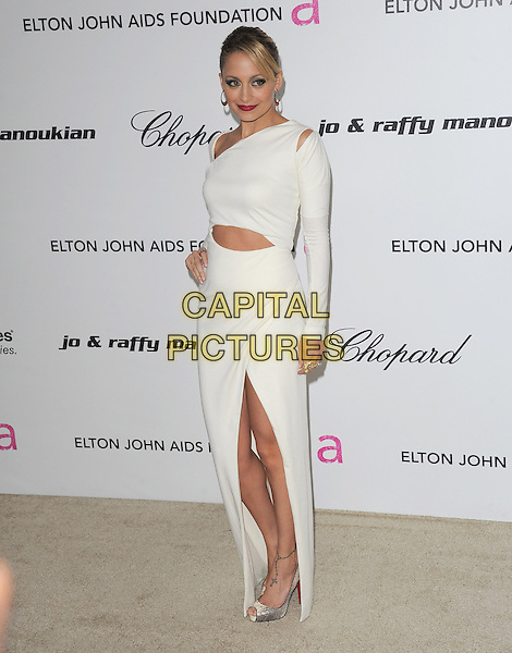 NICOLE RICHIE MADDEN.19th Annual Elton John AIDS Foundation Academy Awards Viewing Party held at The Pacific Design Center, West Hollywood, California, USA..February 27th, 2011.full length white dress slit split long sleeves slash slashed cut out away silver shoes hand on hip.CAP/RKE/DVS.©DVS/RockinExposures/Capital Pictures.