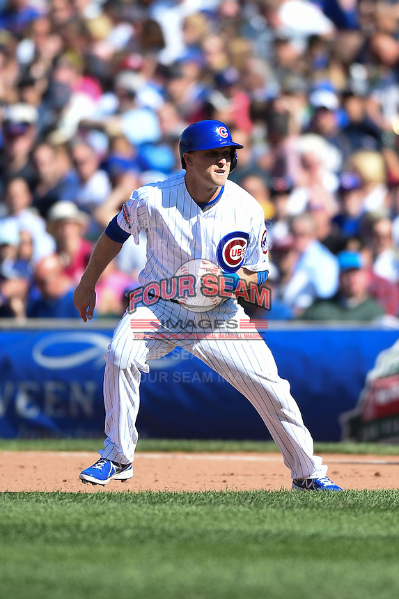 Chicago Cubs pinch hitter Chris Valaika (4) leads off first during a game against the Milwaukee Brewers on August 14, 2014 at Wrigley Field in Chicago, Illinois.  Milwaukee defeated Chicago 6-2.  (Mike Janes/Four Seam Images)