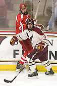 Jeremy Hynes (BU - 4), Billy Scannell (BC - 9) - The Boston College Eagles defeated the visiting Boston University Terriers 6-2 in ACHA play on Sunday, December 4, 2011, at Kelley Rink in Conte Forum in Chestnut Hill, Massachusetts.