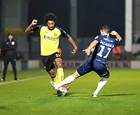 3rd December 2019; Pirelli Stadium, Burton Upon Trent, Staffordshire, England; English League One Football, Burton Albion versus Southend United; Richard Nartey of Burton Albion with the ball at his feet as Stephen McLaughlin of Southend United comes in for a tackle  - Strictly Editorial Use Only. No use with unauthorized audio, video, data, fixture lists, club/league logos or 'live' services. Online in-match use limited to 120 images, no video emulation. No use in betting, games or single club/league/player publications