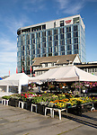 Thon Hotel building and market flower stall, Svolvaer, Lofoten Islands, Nordland, Norway