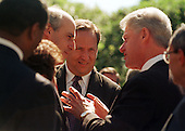 United States President Bill Clinton discusses his veto with members of his cabinet in the Rose Garden on September 23, 1999. From left to right: U.S. Secretary of Agriculture Dan Glickman; U.S. Secretary of the Treasury Lawrence Summers; President Clinton; White House Chief of Staff John Podesta..Credit: Ron Sachs / CNP