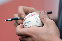Memphis Redbirds pitcher Eric Fornataro signing a baseball before a game against the Oklahoma City RedHawks on May 23, 2014 at AutoZone Park in Memphis, Tennessee.  Oklahoma City defeated Memphis 12-10.  (Mike Janes/Four Seam Images)